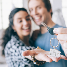 Couple holding keys to home