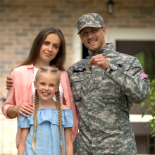 Military father with family holding key